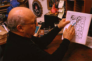 Photo of E.J. Gold demonstrating how to draw
